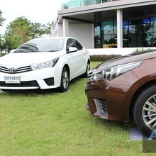 2014_Toyota_Corolla_Altis_CNG_Covedr